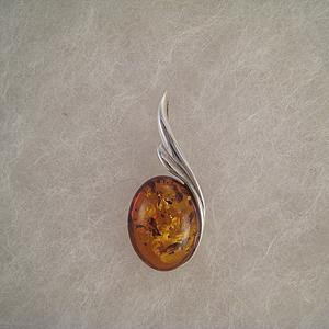 Pendentif boule d'ambre aillée  - bijou ambre et argent