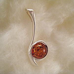 Pendentif perle incurvée - bijou ambre et argent